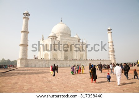 Agra, India - 2015, January 10 : A number of tourists visiting the famous landmark of the Taj Mahal in Agra in the Indian state of Uttar Pradesh - stock photo