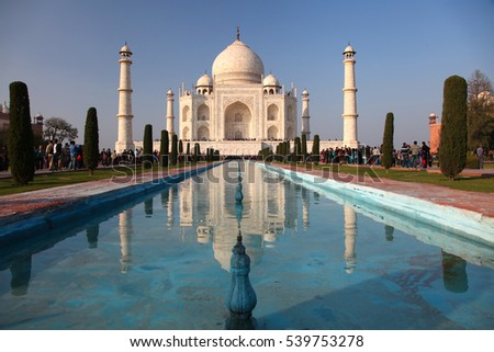 Agra. India - January 26, 2013: Amazing Taj Mahal with some tourist around in Agra in India.
