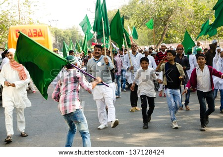 AGRA, INDIA - 25 JANUARY: Muslims celebrate the Milad Un Nabi festival on 25 January 2013 in Agra. Also known as Mawlid, the festival celebrates the birth of the Islamic prophet Muhammad. - stock photo