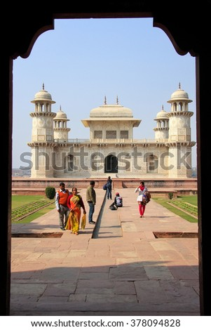 AGRA, INDIA - JANUARY 29: Unidentified people walk near Itimad-ud-Daulah Tomb on January 29, 2011  in Agra, India. This Tomb is often regarded as a draft of the Taj Mahal. - stock photo