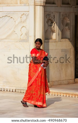 AGRA, INDIA -JANUARY 29: Unidentified woman walks in Khas Mahal in Agra Fort on January 29, 2011 in Agra, India. The fort was built primarily as a military structure but was later upgraded to a palace
