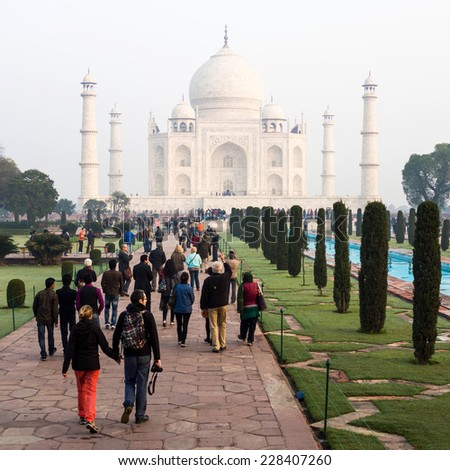 Agra, India - January 18: Visitors entering the Taj Mahal complex early morning in Agra, Uttar Pradesh, India.  - stock photo