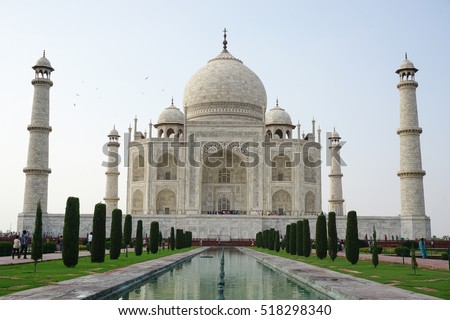 Agra, India - Jul 13, 2015. Indian people visit Taj Mahal in Agra, India. It is one of the worlds most celebrated structures and a symbol of Indias rich history.