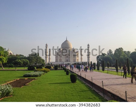 AGRA, INDIA - JUL 12 : The tourist visit Taj Mahal, Agra, India on July 12, 2014. The Taj Mahal is a mausoleum located in Agra, India and is one of the most recognizable structures in the world