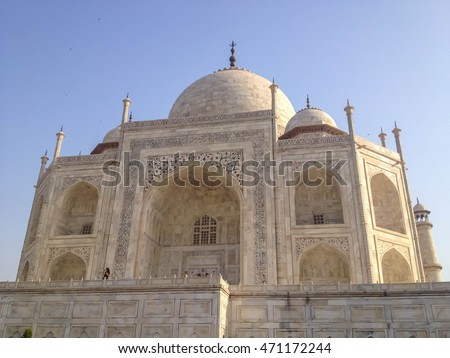 AGRA, INDIA - JULY 12, 2014 : Taj Mahal is an ivory-white marble mausoleum on the south bank of the Yamuna river in the Indian city of Agra, India.