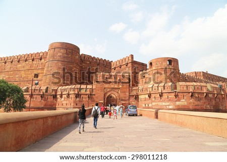 Agra India - July 1 2015 : Tourists walking into Agra Red Fort, a Unesco World Heritage site, and one of the biggest tourist highlights, just 2 km of Taj Mahal. - stock photo