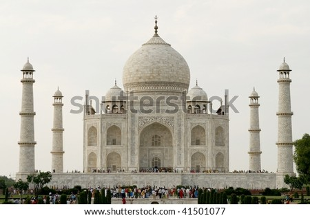 AGRA, INDIA - JUNE 17: People visiting the most known religious site in India - the Taj Mahal mosque in Agra on June 17, 2007 in Agra, India. It's one of The Seven Wonders of the World