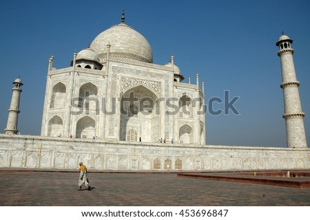 AGRA, INDIA - MARCH 07, 2006: A man walks along the lonely esplanade that extends under the building of the Taj Mahal