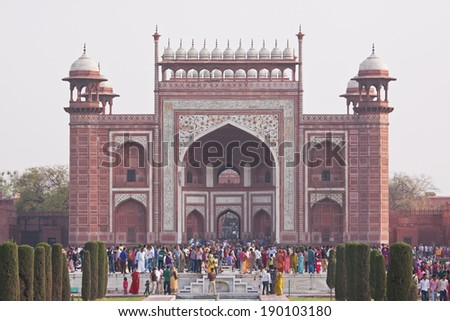AGRA, INDIA - MARCH 25, 2014: Throngs of tourists at the grand ornate entrance gateway to the Taj Mahal world heritage site