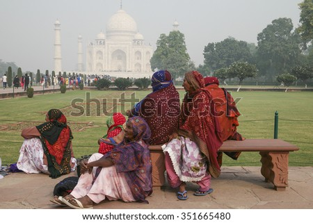 Agra, India-November 29, 2015:Unidentified local people and visitor having a rest after visiting Taj Mahal in Agra, Uttar Pradesh, India.  - stock photo