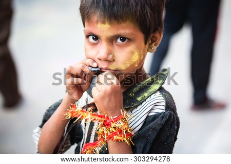 Agra, India - 03 October, 2014: Portrait of Indian girl in the crowd during Durga Puja celebrations on the street of Agra on 03 October, 2014, Agra, India. - stock photo