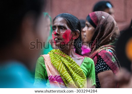 Agra, India - 03 October, 2014: Portrait of Indian woman in the crowd during Durga Puja celebrations on the street of Agra on 03 October, 2014, Agra, India. - stock photo