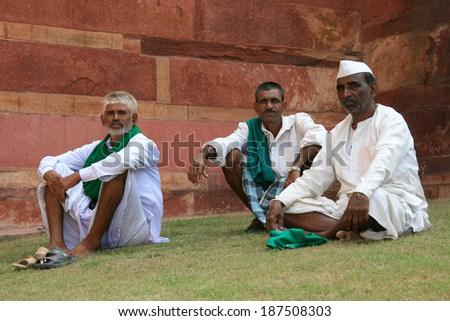 AGRA, INDIA - OCTOBER 9 2007: Religious men on a pilgramage rest at the famous Agra Fort in Agra, India