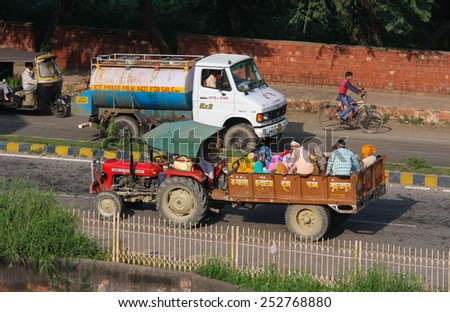 AGRA, INDIA - SEPTEMBER 21, 2008: Traffic on a local street in Agra, Uttar Pradesh, India. - stock photo