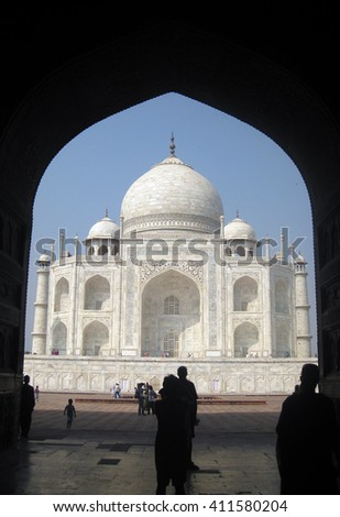 Agra, Uttar Prades, India - October 2011: View of the Taj Mahal from the main door of the mosque and visitors. - stock photo