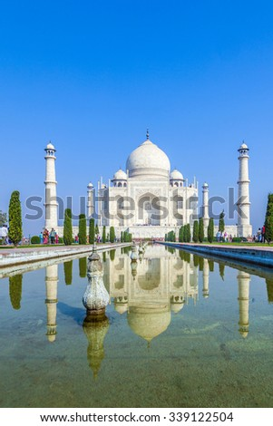 Agra, Uttar Pradesh, India - NOV 16, 2011: Visitors at the Taj Mahal complex in Agra, Uttar Pradesh, India. The Taj is still the only existing wonder of the world. - stock photo