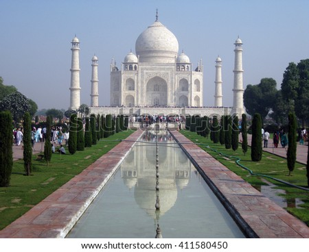 Agra, Uttar Pradesh, India - October 2011: Frontal view of the Taj Mahal, one of the New Seven Wonders of the World and visitors. - stock photo
