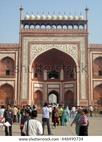 Agra, Uttar Pradesh, India - October 2011: Tourists at the main gateway of the Taj Mahal. - stock photo