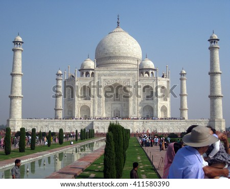 Agra, Uttar Pradesh, India - October 2011: Tourists at the Taj Mahal, one of the New Seven Wonders of the World.  - stock photo