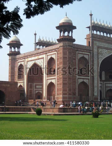 Agra, Uttar Pradesh, India - October 2011: View of the Darwaza and visitors, or main entrance to the Taj Mahal, one of the New Seven Wonders of the World. - stock photo