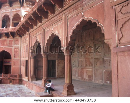 Agra, Uttar Pradesh, India - October 2011: View of the mosque of the Taj Mahal and visitors. - stock photo