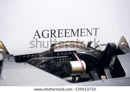 Agreement on typewriter - stock photo