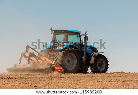 Agricultural activities, modern farm equipment in field - stock photo