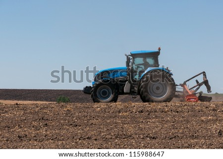 Agricultural activities, modern farm equipment in field