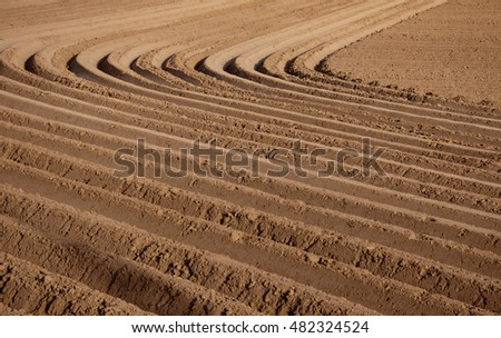 Agricultural background of newly plowed field ready for new crops