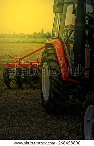 Agricultural equipment in sunset light. Image digitally manipulated. - stock photo