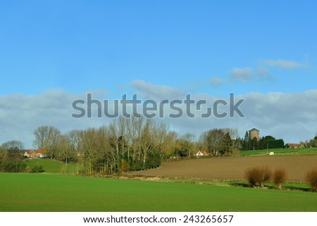 Agricultural landscape of Flemish Ardennes in warm winter day