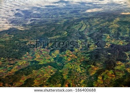 Agricultural region with fields, villages and hills aerial view - stock photo