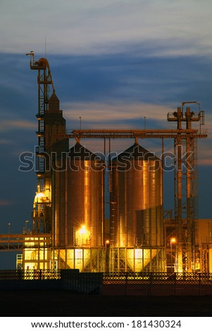 Agricultural Silo - Building Exterior, Storage and drying of grains, wheat, corn, soy, sunflower .Night photo. - stock photo