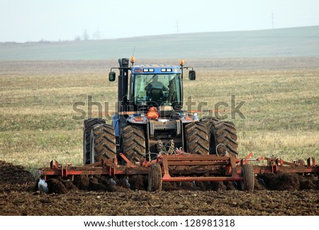 agricultural work in processing, cultivation of land in Russia - stock photo