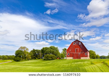Agriculture Landscape With Old Red Barn - stock photo