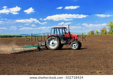 Agriculture machinery in field. - stock photo