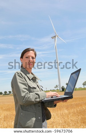 Agronomist in wheat field - stock photo