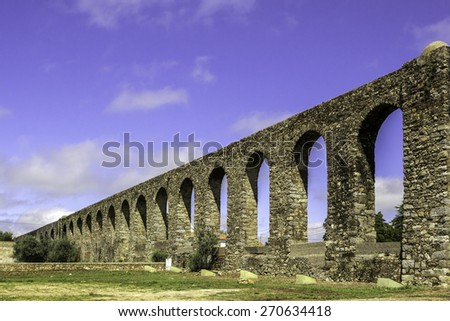 Agua de Prata Aqueduct (Aqueduct of Silver Water) in Evora, Portugal. Its arches stretch for 9 kilometres (6 miles), the aqueduct was built in 1531-1537 by King Joao III to supply the city with water. - stock photo
