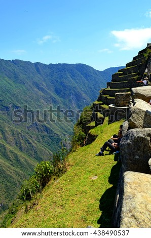 AGUAS CALIENTES, PERU - SEPTEMBER 10, 2014: Tourists observing the landscape around the Machu Picchu, near Aguas Calientes, Peru