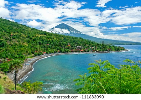 Agung volcano is the highest mountain on Bali island, Indonesia.  It is still active and located near Amed -- a small village on the northeast of Bali. - stock photo