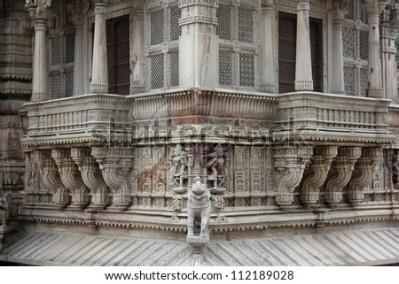 AHMEDABAD, GUJARAT, INDIA - AUGUST 21 : Hutheesing Jain Temple on August 21, 2012 in Ahmedabad. Beautiful stone carving patterns on Jali & decorative desings on the balcony known as ' Gudhamandapa '. - stock photo