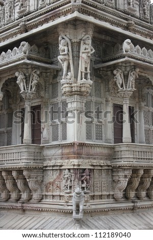 AHMEDABAD, GUJARAT, INDIA - AUGUST 21 : Hutheesing Jain Temple on August 21, 2012 in Ahmedabad. View of the amazingly carved & decorated porch known as ' Gudhamandapa ' from the corner. - stock photo