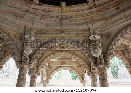 AHMEDABAD, GUJARAT, INDIA - AUGUST 21 : Hutheesing Jain Temple on August 21, 2012 in Ahmedabad. Ornamental stone carving on arches, columns & ceiling of 'Rangamandapa' hall for musical performances. - stock photo