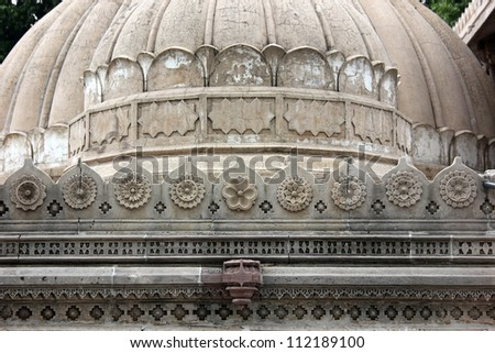 AHMEDABAD, GUJARAT, INDIA - AUGUST 21 : Hutheesing Jain Temple on August 21, 2012 in Ahmedabad. Dome on 'Rangamandapa', hall for musical performances, with floral patterns & borders carved in marble. - stock photo
