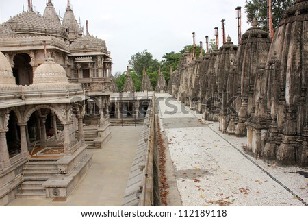 AHMEDABAD, GUJARAT, INDIA - AUGUST 21 : Hutheesing Jain Temple on August 21, 2012 in Ahmedabad. View from the top west. Main temple building on the left & small temples on right & in east. - stock photo