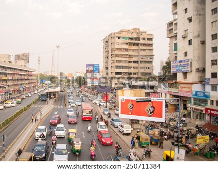 Ahmedabad, India - February 06, 2015: Typical  volume traffic scene in Ahmedabad.  Auto rickshaws and Bus Rapid Transport (BRT) buses provide public transportation. - stock photo