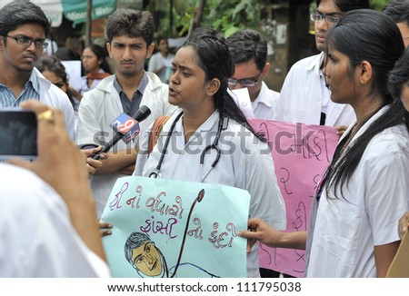 AHMEDABAD, INDIA - SEP 02: Medical students on strike, protesting against an exorbitant fee increase of 100% by the state municipality run medical school on September 02, 2012 in Ahmedabad, India