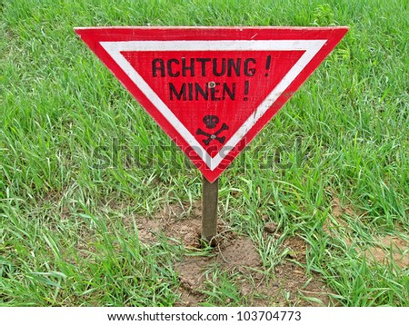 "ahtung minen as text on german language, danger red sign warning ""Attention Mines"""