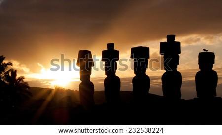 Ahu Nau Nau Statues. A row of moai statues on Isla de Pascua in the South Pacific ocean. - stock photo