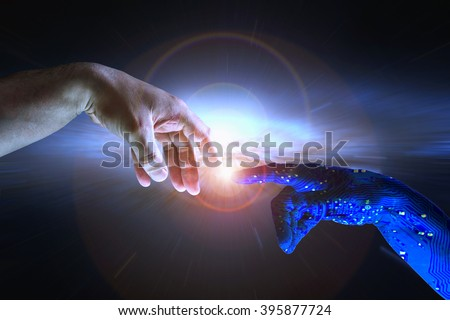 AI hand reaches towards a human hand as a spark of understanding technology reaches across to humanity. Artificial Intelligence concept copy space area. Blue cyborg arm and flare science background - stock photo
